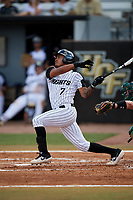 UCF Knights shortstop Brandon Hernandez (7) follows through on a swing during a game against the Siena Saints on February 17, 2019 at John Euliano Park in Orlando, Florida.  UCF defeated Siena 7-1.  (Mike Janes/Four Seam Images)