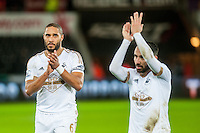 Ashley Williams of Swansea and Leon Britton of Swansea  applaud the fans after the Barclays Premier League match between Swansea City and West Ham United played at the Liberty Stadium, Swansea  on December 20th 2015