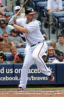 Atlanta Braves catcher David Ross #8 swings at a pitch during a game against the Colorado Rockies at Turner Field on September 3, 2012 in Atlanta, Georgia. The Braves  defeated the Rockies 6-1. (Tony Farlow/Four Seam Images).
