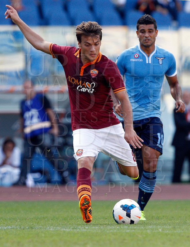 Calcio, Serie A: Roma vs Lazio. Roma, stadio Olimpico, 22 settembre 2013.<br /> AS Roma forward Adem Ljajic, of Serbia,  kicks the ball past Lazio midfielder Ederson, of Brazil, right, during the Italian Serie A football match between AS Roma and Lazio, at Rome's Olympic stadium, 22 September 2013.<br /> UPDATE IMAGES PRESS/Riccardo De Luca
