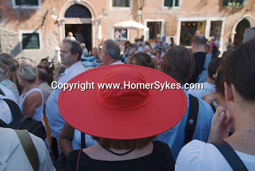 Woman wearing a red hat Accademia Bridge, Venice, Italy. 2009