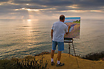 Artist Bill Jewell plein aire painting on coastal bluff overlooking the ocean at Sunset Cliffs, San Diego, California