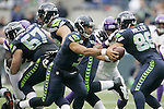 Seattle Seahawks quarterback Russell Wilson looks to hand off against the Minnesota Vikings at CenturyLink Field in Seattle, Washington on  November 4, 2012.  Wilson completed 16 of 24 passes for 173 yards and three touchdowns in the Seahawks 30-20 win over the Vikings.    ©2012. Jim Bryant Photo. All Rights Reserved.