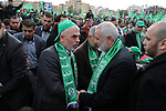 Chairman of the political bureau of the Hamas Palestinian Islamist movement, Ismail Haniyeh and Hamas's leader in the Gaza Strip Yahya Sinwar arrive to attend a rally marking the 31th anniversary of the founding of the Hamas movement, in Gaza city, December 16, 2018. Photo by Ashraf Amra