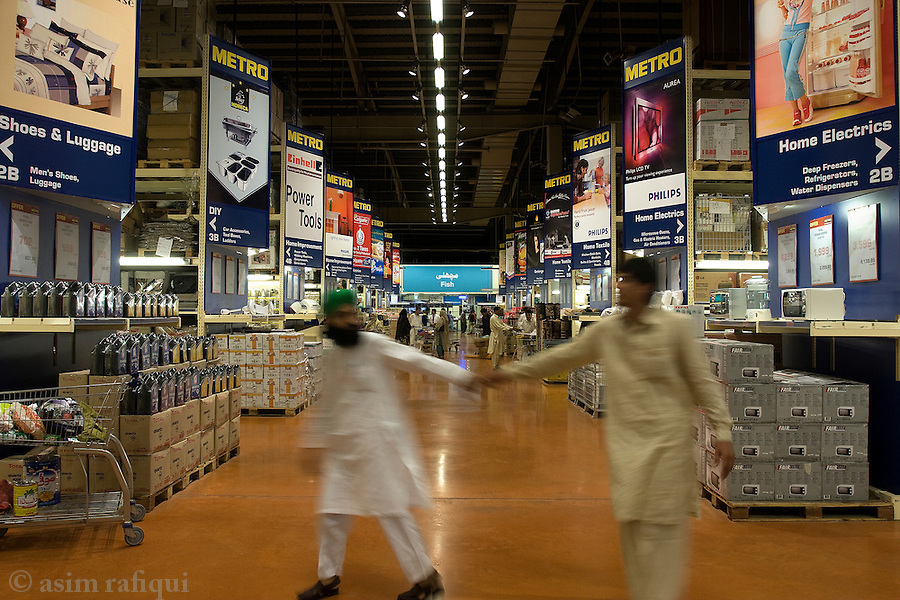 Inside a Metro superstore - such warehouse shopping stores have sprung up in most all major Pakistani cities.  Catering to a rising middle class, such stores offer the usual convenience of air-conditioned shopping environments, one-stop avaliablity of all major necessities and fresh produce offered and prepared in hygienic conditions.