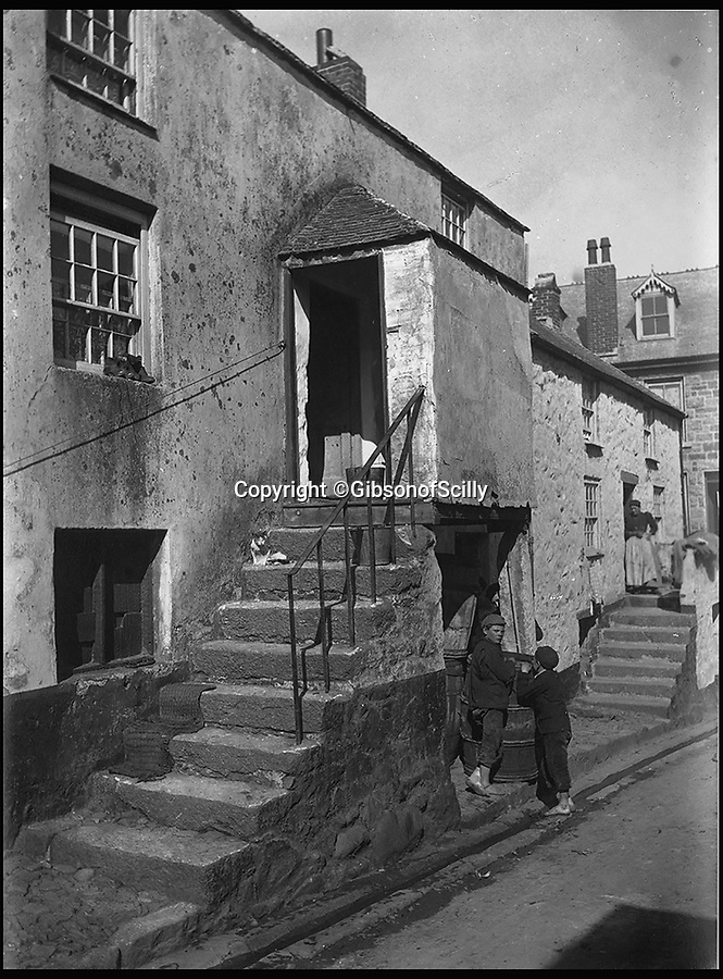 BNPS.co.uk (01202 558833)<br /> Pic: GibsonOfScilly/BNPS<br /> <br /> St Ives around 1900.<br /> <br /> An archive of eye-opening photographs documenting the grim reality of Poldark's Cornwall has emerged for sale for £25,000.<br /> <br /> More than 1,500 black and white images show the gritty lives lived by poverty-stricken families in late 19th and early 20th century Cornwall - around the same time that Winston Graham's famous Poldark novels were set.<br /> <br /> The collection reveals the lowly beginnings of towns like Rock, Fowey, Newquay and St Ives long before they became picture-postcard tourist hotspots.<br /> <br /> Images show young filth-covered children playing barefoot in squalid streets, impoverished families standing around outside the local tax office, and weather-beaten fishwives tending to the day's catch.<br /> <br /> The Cornish archive, comprising 1,200 original photographic prints and 300 glass negative plates, is tipped to fetch £25,000 when it goes under the hammer as one lot at Penzance Auction House.