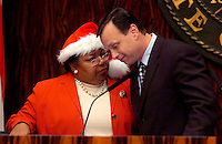 TALLAHASSEE, FL. 12/8/05-Sen. Larcenia Bullard, R-Miami, left, talks with Senate President Tom Lee, R-Brandon, as the Senate prepares to approve the lobbyist reform bill, Thursday at the Capitol in Tallahassee. Bullard voted for the bill. COLIN HACKLEY PHOTO