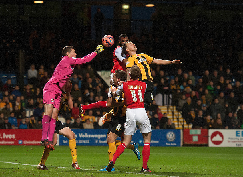 Cambridge United's goalkeeper Chris Dunn punches clear from Fleetwood Town's Nathan Pond<br /> <br /> Photographer Stephen White/CameraSport<br /> <br /> Football - FA Challenge Cup First Round - Cambridge United v Fleetwood Town - Saturday 8th November 2014 - R Costings Abbey Stadium - Cambridge<br /> <br />  &copy; CameraSport - 43 Linden Ave. Countesthorpe. Leicester. England. LE8 5PG - Tel: +44 (0) 116 277 4147 - admin@camerasport.com - www.camerasport.com