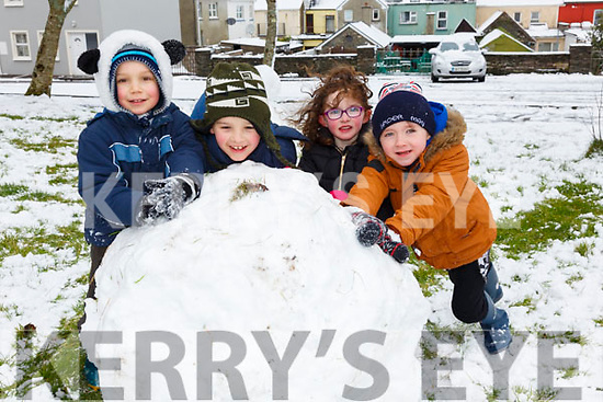 Lesson one in building a snowman 'roll a big base' pictured here l-r; Andrzej Lesniak, Sebastian Lesniak, Emma O'Neill & Tadhg Clifford.