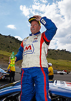 Jul 24, 2016; Morrison, CO, USA; NHRA pro stock driver Allen Johnson celebrates after winning the Mile High Nationals at Bandimere Speedway. Mandatory Credit: Mark J. Rebilas-USA TODAY Sports