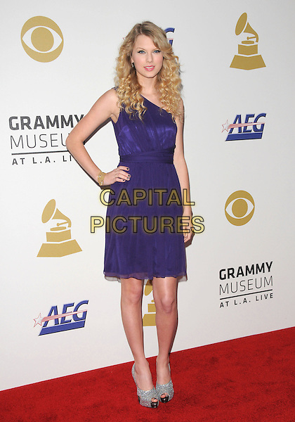 TAYLOR SWIFT .attends The GRAMMY Nominations Concert Live!! held at Nokia Theatre L.A. Live in Los Angeles, California on December 3rd 2008..full length black ink purple dress one shoulder hand on hip silver platform shoes peep toe  .CAP/DVS.©Debbie VanStory/Capital Pictures