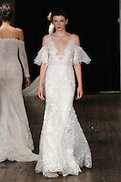 """Model walks runway in a """"Beloved"""" bridal gown from the Rivini by Rita Vinieris Fall 2017 collection on October 7th, 2016 during New York Bridal Fashion Week."""