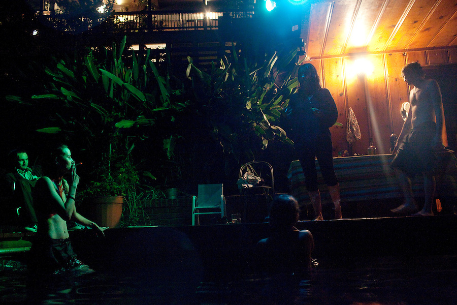Los Angeles, California, August 1, 2009 - Warpaint drummer, Josh Klinghoffer, guitarist/keyboardist, Theresa Wayman, guitarist, Emily Kokal, Bassist, Jenny Lee Lindberg, and Moonrats guitarist, Nathan Thelen enjoy a relaxing night of swimming at Thelen's pool in the hills above Studio City. The two bands just finished a 10-day tour of the west coast. ..