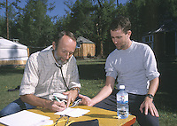 25 JUN 2002 - KHOVSGOL NATIONAL PARK, MONGOLIA - Gunnar Faehn makes medical checks Ian Smith before clearing Ian Smith to compete in the Mongolia Sunrise to Sunset. (PHOTO (C) NIGEL FARROW)