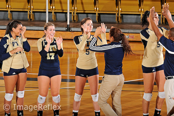 11 September 2011:  FIU's team (pictured, Paola Ortiz (11), Carolyn Fouts (17), Rachel Fernandez (5)) high-fives after winning the match.  The FIU Golden Panthers defeated the Florida A&M University Rattlers, 3-0 (25-10, 25-23, 26-24), at U.S Century Bank Arena in Miami, Florida.