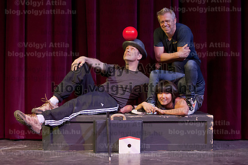 Juggler Steven Ragatz (L) and Contortionist Gana Ganchimeg (bottom R) members of the Cirque Mechanics company led by Chris Lashua (top R) pose for photographers during a press conference of their show Bird House Factory they present in Budapest, Hungary on April 28, 2011. ATTILA VOLGYI