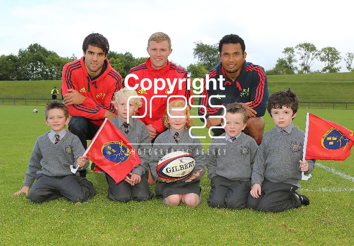 """12/9/2012  With compliments Pictured at the launch of the Brown Thomas and Munster Rugby primary schools initiative programme are Munster rugby players Conor Murray, Keith Earls and Casey Laulala with Parteen NS pupils David Keane(7), Cian O'Halloran(9), Ella O'Halloran(6), Mark Keane(5) and Rion O'Reilly(6).  As the official sponsors of the Munster Rugby team suiting, the exciting new Brown Thomas Limerick and Munster Rugby """"primary schools outreach initiative will draw the community together, spreading the ethos of the game to all corners of Munster and make the rugby stars more accessible to the children of the area with one lucky child winning a Munster Rugby team visit to their school. Photographs Liam Burke/Press 22"""