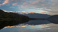 Sunrise at Lake Mapourika with reflections of Mount Tasman and Southern Alps, Westland Tai Poutini National Park, UNESCO World Heritage Area, West Coast, New Zealand, NZ