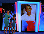 Denver, CO - August 25, 2008 -- Michelle Obama, left, waves to the crowd as her daughters, Malia Ann, and Sasha, wave to United States Senator Barak Obama (Democrat of Illinois) who appeared via a video link-up after Michelle delivered remarks as the prime-time speaker on day 1 of the 2008 Democratic National Convention at the Pepsi Center in Denver, Colorado on Monday, August 25, 2008..Credit: Ron Sachs - CNP.(RESTRICTION: NO New York or New Jersey Newspapers or newspapers within a 75 mile radius of New York City)