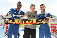 Getafe's new players Bernard Mensah (l) and Victor Rodriguez whit a supporter during their official presentation. August 5, 2014. (ALTERPHOTOS/Acero)