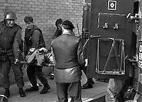 British soldier injured in exchanges with rioters in Rossville Street, Londonderry, N Ireland, UK, is stretched by colleague to a personnel carrier for transfer to hospital.  October 1969. 196910000001..Copyright Image from Larry Doherty, c/o Victor Patterson, 54 Dorchester Park, Belfast, UK, BT9 6RJ..Tel: +44 28 9066 1296.Mob: +44 7802 353836.Voicemail +44 20 8816 7153.Skype: victorpattersonbelfast.Email: victorpatterson@mac.com.Email: victorpatterson@ireland.com (back-up)..IMPORTANT: If you wish to use this image or any other of my images please go to www.victorpatterson.com and click on the Terms & Conditions. Then contact me by email or phone with the reference number(s) of the image(s) concerned.
