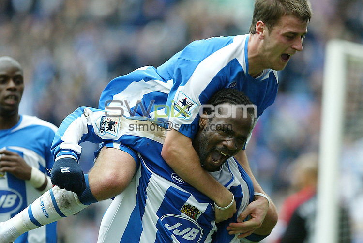 Pix by JOHN CLIFTON/SWpix.com -  Barclays Premiership, Wigan Athletic v Fulham, The JJB Stadium, Wigan, 29/10/05..Picture Copyright >> Simon Wilkinson >> 07811267706..Wigan's Pascal Chimbonda celebrates scoring the winning goal with Ryan Taylor