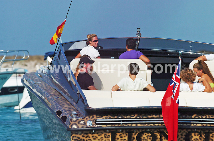 **ALL ROUND EXCLUSIVE PICTURES FROM SOLARPIX.COM**.**WORDLWIDE SYNDICATION RIGHTS EXCEPT FOR SPAIN** NO PUBLICATION IN SPAIN**.Rocky star Sylvester Stallone and wife Jennifer Flavin looked relaxed as they sailed on a huge leopard-skin powerboat with family in Ibiza..JOB REF:   6961      PTB        DATE: 03.08.08.**MUST CREDIT SOLARPIX.COM / POOL PRESS OR DOUBLE FEE WILL BE CHARGED* *UNDER NO CIRCUMSTANCES IS THIS IMAGE TO BE REPRODUCED FOR ANY ONLINE EDITION WITHOUT PRIOR PERMISSION*