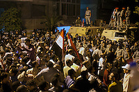 EGITTO, IL CAIRO 9/10 settembre 2011: assalto all'ambasciata israeliana. Migliaia di manifestanti egiziani, ancora infuriati per l'uccisione di cinque guardie di frontiera egiziane da parte dell'esercito israeliano, hanno fatto irruzione nella sede diplomatica israeliana e sono stati poi sgomberati da esercito e polizia egiziana. Nell'immagine: folla di manifestanti con le bandiere dell'Egitto ed esercito sui blindati.<br /> Egypt attack to the Israeli embassy  Attaque &agrave; l'ambassade israelienne Caire
