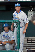 UCLA Coach John Savage communicates with an umpire in Game Two of the NCAA Division One Men's College World Series Finals on June 29th, 2010 at Johnny Rosenblatt Stadium in Omaha, Nebraska.  (Photo by Andrew Woolley / Four Seam Images)