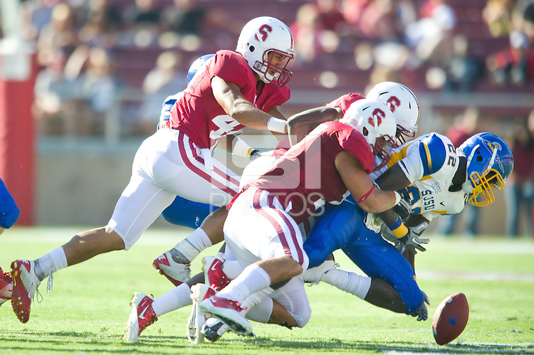 Stanford, Ca-Saturday, Sept. 3, 2010: A.J. Tarpley causes a San Jose State fumble. Stanford defeated San Jose State 57-3 at Stanford Stadium.