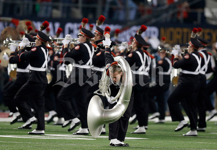 "Band member Justin Pitts dots the ""i"" before the College Football Playoff National Championship at AT&T Stadium in Arlington, TX on Monday, January 12, 2015. (Columbus Dispatch photo by Jonathan Quilter)"