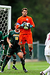 13 September 2009: University of Vermont Catamount goalkeeper Tom Critz, a Senior from Enfield, CT, makes a save against the University of Massachusetts Minutemen during the second round of the 2009 Morgan Stanley Smith Barney Soccer Classic held at Centennial Field in Burlington, Vermont. The Catamounts and Minutemen battled to a 1-1 double-overtime tie. Mandatory Photo Credit: Ed Wolfstein Photo