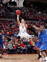Ohio State Buckeyes guard Aaron Craft (4) goes up for two during the first half of the NCAA men's basketball game at Value City Arena on Wednesday, December 18, 2013. (Columbus Dispatch photo by Jonathan Quilter)