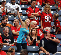A lone Jacksonville Jaguars fan cheers for her team to the chagrin of Houston Texans fans during the Jags at Reliant Stadium in Houston, Texas. (The Florida Times-Union, Rick Wilson)