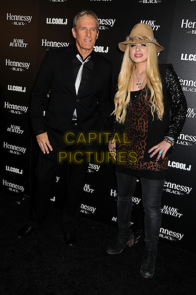 Michael Bolton, Orianthi.Hennessy Toasts Achievements in Music with Grammy Host LL Cool J and Mark Burnett held at the SLS Hotel, Los Angeles, California, USA, .9th February 2013..full length black shirt silver tie suit brown leopard print top hat jeans black leather jacket .CAP/ADM/BP.©Byron Purvis/AdMedia/Capital Pictures.