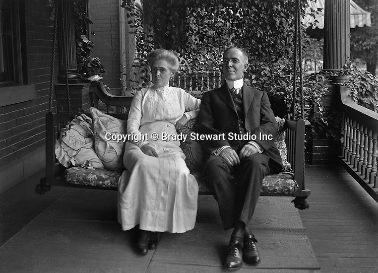 Highland Park PA: Alice Brady Stewart and her brother on the front porch swing of Brady Stewart's home on Wellesley Avenue - 1916