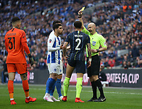 Manchester City's Kyle Walker receives a yellow card from referee Anthony Taylor<br /> <br /> Photographer Rob Newell/CameraSport<br /> <br /> Emirates FA Cup Semi-Final - Manchester City v Brighton & Hove Allbion - Saturday 6th April 2019 - Wembley Stadium - London<br />  <br /> World Copyright © 2019 CameraSport. All rights reserved. 43 Linden Ave. Countesthorpe. Leicester. England. LE8 5PG - Tel: +44 (0) 116 277 4147 - admin@camerasport.com - www.camerasport.com