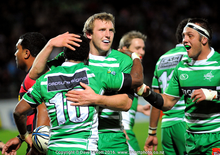Hadleigh Parkes and Doug Tietjens congratulate Manawatu first fiveTomasi Cama on his try. ITM Cup rugby - Manawatu Turbos v Canterbury at FMG Stadium, Palmerston North, New Zealand on Friday, 5 August 2010. Photo: Dave Lintott / lintottphoto.co.nz