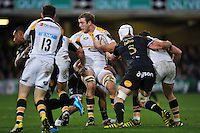 Joe Launchbury of Wasps takes on the Bath Rugby defence. European Rugby Champions Cup match, between Bath Rugby and Wasps on December 19, 2015 at the Recreation Ground in Bath, England. Photo by: Patrick Khachfe / Onside Images