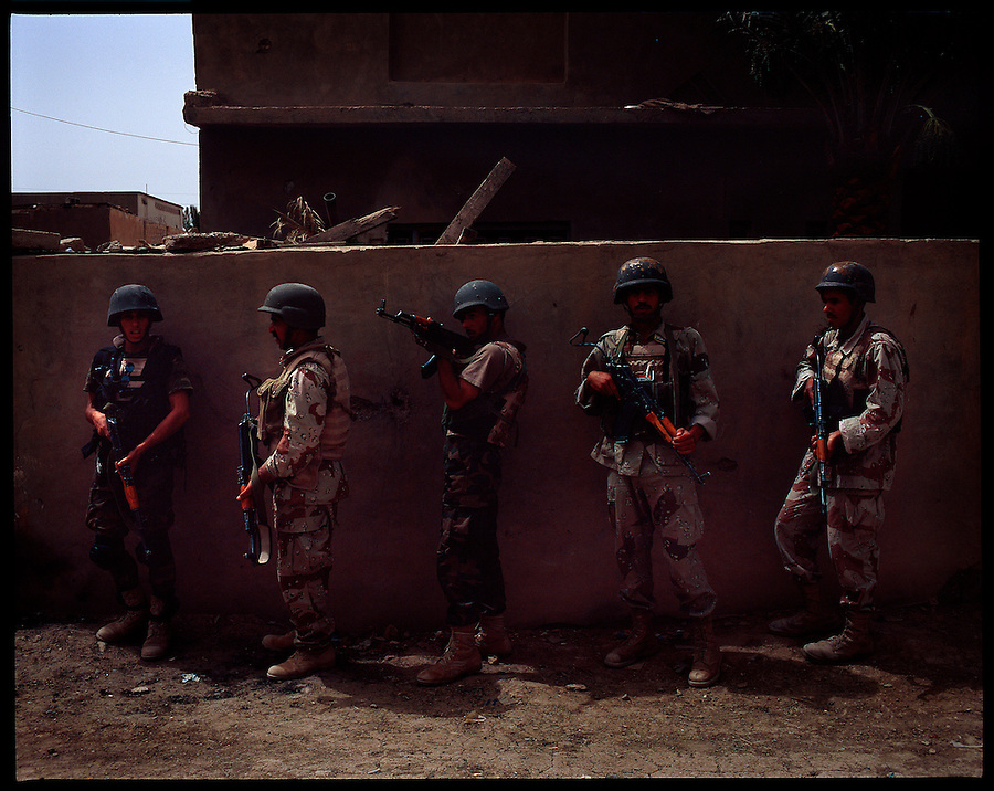 Iraqi soldiers take part in a joint patrol with US troops in the Tahrir district of the Diyala provincial capital, Baqubah, on Monday May 28, 2007.