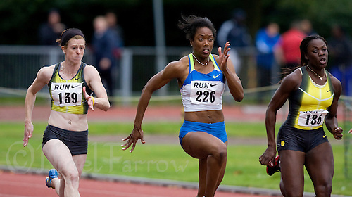 17 JUL 2008 - LOUGHBOROUGH, UK - Montell Douglas (centre) powers through to break the British womens 100m record in a time of 11.05 seconds, flanked by Laura Turner and Toyin Olupona - 100m -  Loughborough European Athletics Permit Meeting. (PHOTO (C) NIGEL FARROW)