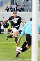 Wilder Arboleda (20) of the Providence Friars runs onto a ball as Louisville Cardinals goalkeeper Andre Boudreaux (30) moves to cover. The Louisville Cardinals defeated the Providence Friars 3-2 in penalty kicks after playing to a 1-1 tie during the finals of the Big East Men's Soccer Championship at Red Bull Arena in Harrison, NJ, on November 14, 2010.