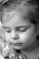 Toddler portrait close up. Black and white photography.