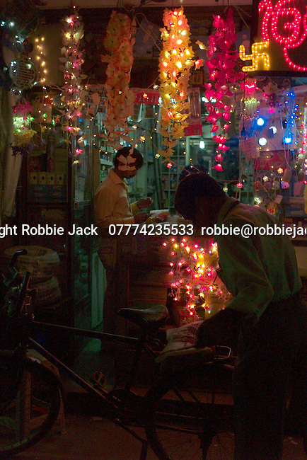 Shop selling coulored lights  in the Paharganj district of New Delhi, India.