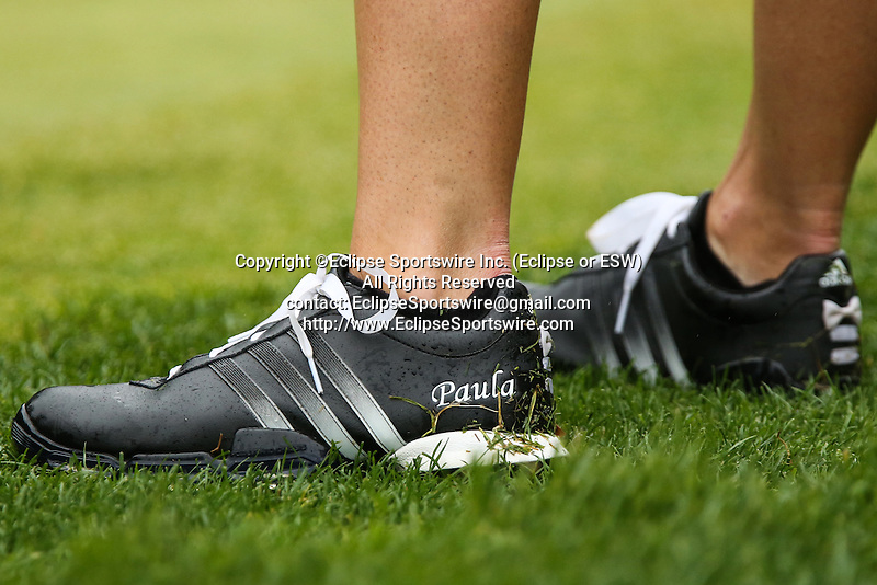 American Paula Creamer shows off her black shoes that has her name on them on the fourth hole at the LPGA Championship at Locust Hill Country Club in Pittsford, NY on June 7, 2013