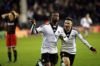 Moussa Dembele scores and celebrates his third goal for Fulham