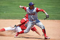 Williamsport Crosscutters shortstop Grenny Cumana (2) throws to first as Blake Anderson (26) slides into second during a game against the Batavia Muckdogs on July 16, 2015 at Dwyer Stadium in Batavia, New York.  Batavia defeated Williamsport 4-2.  (Mike Janes/Four Seam Images)