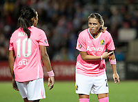 Camile Abily (right) talks to Marta (left) before the free kick. FC Gold Pride tied the Chicago Red Stars 0-0 in PUMA's Project Pink, Think Pink, Breast Cancer Awareness game at Pioneer Stadium in Hayward, California on August 7th, 2010.