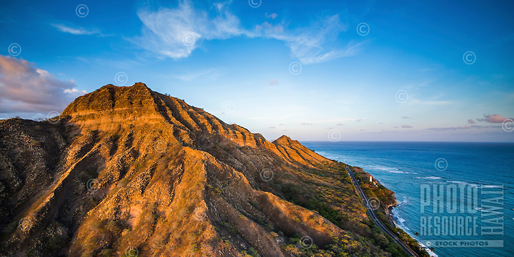 A sunset glow over Diamond Head Crater and Road, East O'ahu.
