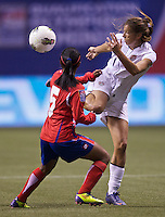 Tobin Heath, right, of the United States gets control of the ball in front of Diana Saenz of Costa Rica during play in the CONCACAF Olympic Qualifying semifinal match at BC Place in Vancouver, B.C., Canada Friday Jan. 27, 2012. The United States won the match 3-0 to earn a berth in 2012 London Olympics.